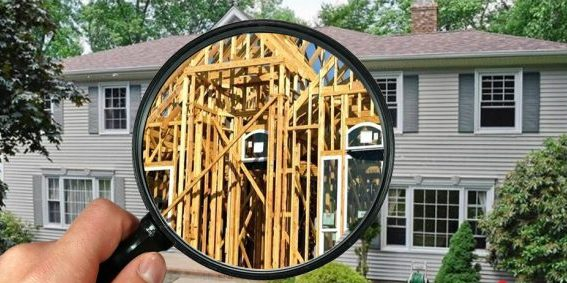Construction experience - house with magnifying glass showing the house framing